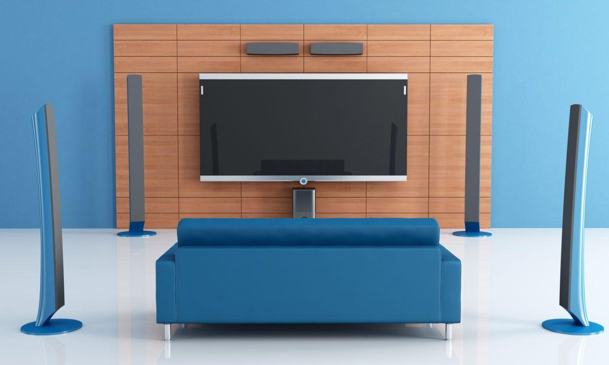 home theater setup blue sofa and surround sound speakers