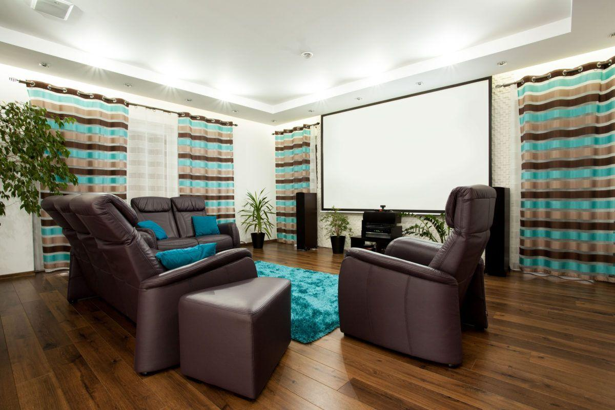 home theater setup with projector screen leather seats curtains